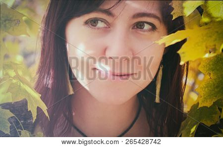 Happy Young Teenager Girl Reads Book Among Flowers. Adorable Teenager Girl Having Fun In Flowering D