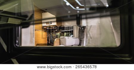 Outside Standing And Looking Through A Window Of A Caravan, Switzerland