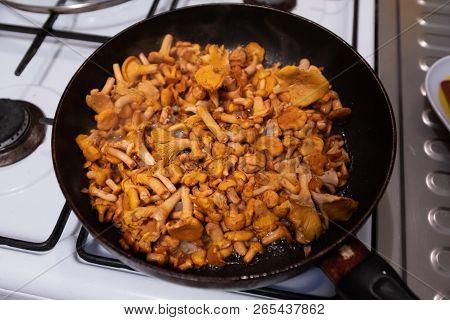 Mushrooms On Black Frying Pan Top View