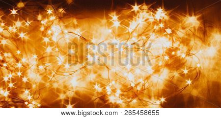 Beautiful Garland With Little Lights. Orange Toning. Christmas Coming Concept.