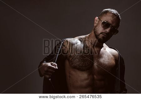 Portrait Of Handsome Male Model In Fashion Jacket And Stylish Glasses. Confident And Handsome Brutal