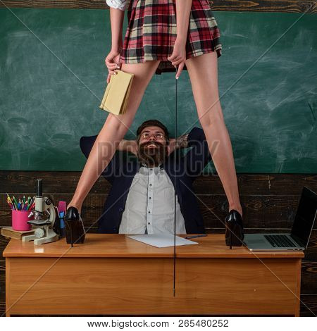 First Sexual Experience. Human Sexuality Lesson Plans. Bearded Teacher Looks At Sexy Female Students