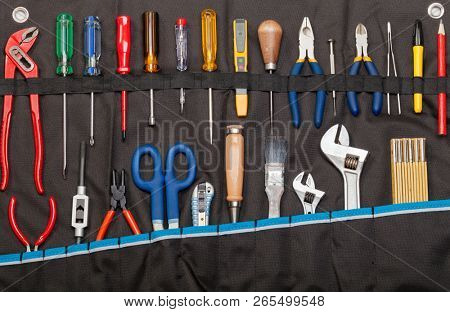 Toolbelt with set of tools - screwdrivers ruler nippers  wrenches pliers pencil  cutter scissors brush chisel - DIY consept poster