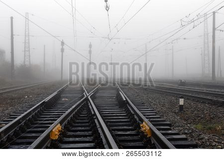Crossing Railways  Fading Away Disappearing In The Mist In Autumn Morning