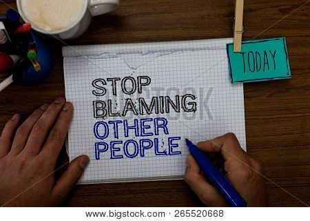 Conceptual hand writing showing Stop Blaming Other People. Business photo showcasing Do not make excuses assume your faults guilt Hand hold pen paper clip written notepad pen case coffee mug. poster
