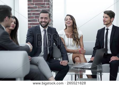 handshake business partners in an informal meeting