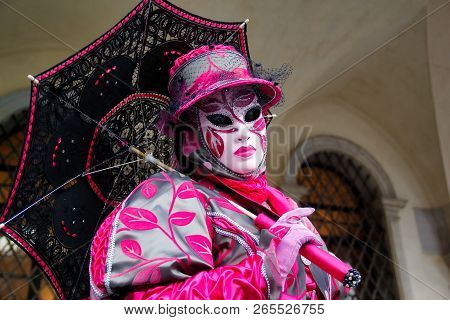 Colorful Carnival Pink-grey-black Mask And Costume At The Traditional Festival In Venice, Italy