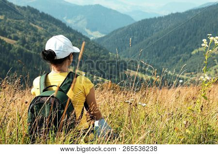 Woman With Backpack In Wilderness. Mountain Landscape