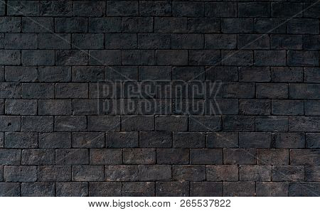 Black And Brown Brick Wall Rough Texture Background With Space For Text. Background For Death, Sad,