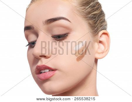 Young Woman With Different Shades Of Skin Foundation On Her Face Against White Background. Professio