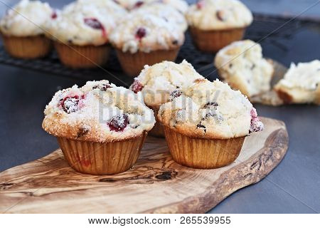 Cranberry Muffins With Lemon Sugar Topping On A Rustic Cutting Board With Loose Berries. Extreme Sha