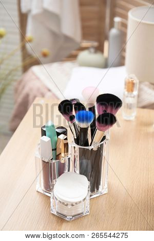 Organizer With Makeup Cosmetic Products On Wooden Table In Room