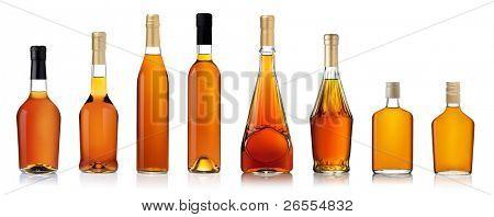 Set of brandy bottles isolated on white background
