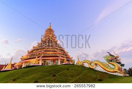 Double Dragon And Pagoda At Wat Huay Pla Kang On Sunset Time, Chinese Temple In Chiang Rai Province,