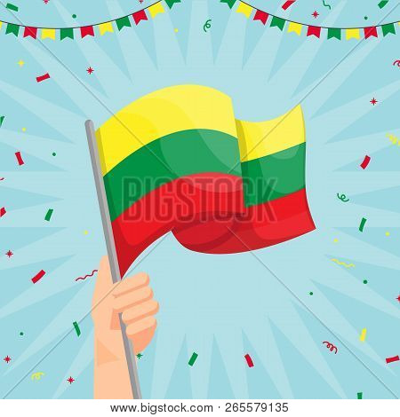 Hand Holding Lithuania Flag. Lithuania Flag In Cartoon Style. Winner Concept. Confetti Concept. Vect