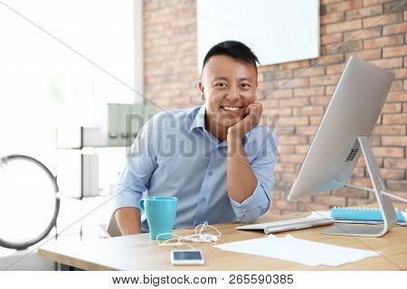Happy Young Businessman Enjoying Peaceful Moment At Workplace