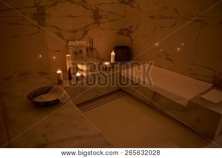Side View Of The Turkish Bath With White Towels And Candles