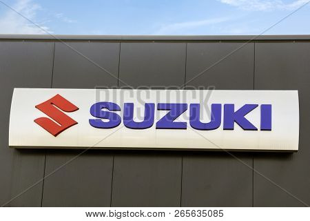 Wetzlar - March 25 2018: Suzuki Motor Corporation Logo. Suzuki Motor Corporation Is A Japanese Multi