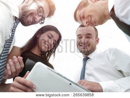 closeup of business team looking at digital tablet.