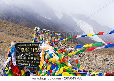 Information Sign And Prayer Flags On Thorang-la Pass, Annapurna Conservation Area, Nepal