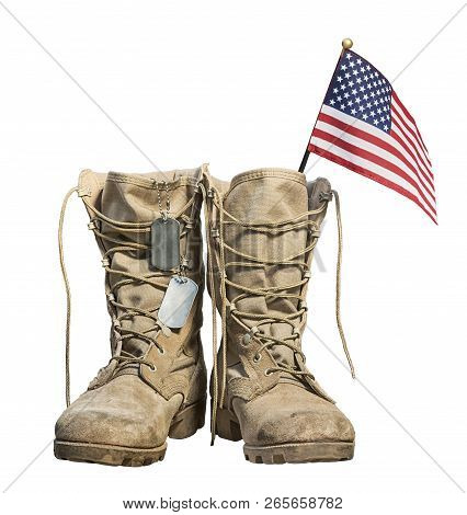 Old Military Combat Boots With The American Flag And Dog Tags, Isolated On White Background. Memoria