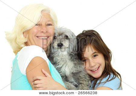 Grandmother and girl hugging the family dog isolated on a white background poster