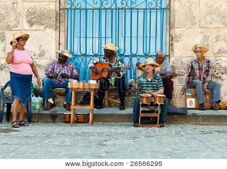 HAVANA-JANUARY 11:Street musicians January 11,2011 in Havana.With Cuba receiving over two million tourists a year people like these,usually working for tips;are part of the atmosphere of Old Havana