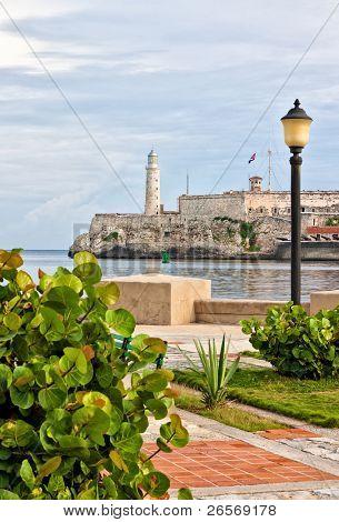 The famous castle of El Morro in Havana seen from a beautiful park across the bay
