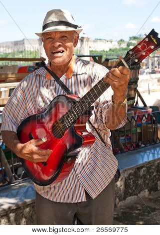 HAVANA - OCT 20: Musician playing for tourists October 20,2011 in Havana. Very famous through the world, the Cuban music is an attraction for the more than 2 million people who visit Cuba every year