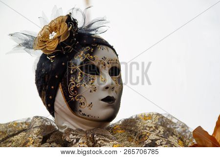 Carnival Gold-black Mask And Costume At The Traditional Festival In Venice, Italy