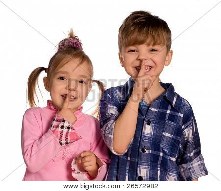 shhh... Funny little boy and girl. Good for borders of articles or websites. Beautiful caucasian model. Isolated on white background.