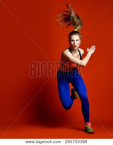 Runner Woman Isolated. Running Fit Fitness Sport Model With Long Hair In Pony Tail In Blue Pants Gym