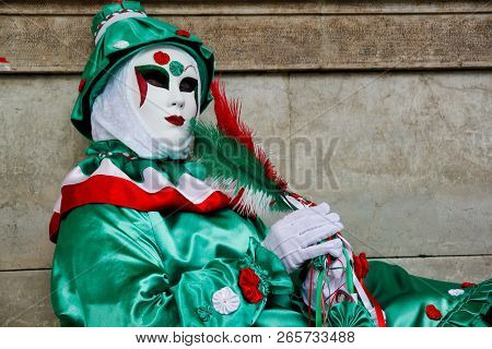 Carnival Green-white-red Mask And Costume At The Traditional Festival In Venice, Italy