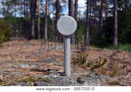Modern geodesic sign in the forest,June 23. 2018. Rakkestad Community,Norway