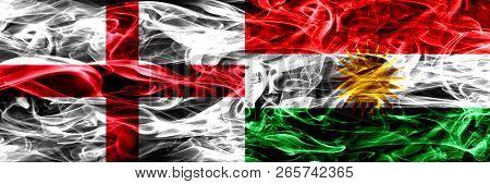 England Vs Kurdistan, Kurdish Smoke Flags Placed Side By Side. Thick Colored Silky Smoke Flags Of En