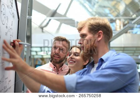 Casual Business People Working With Whiteboard In Office.