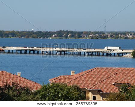 The I-30 Causeway Bridge Crossing Lake Ray Hubbard Recreational Area. The Red Tile Roofs Of The Harb