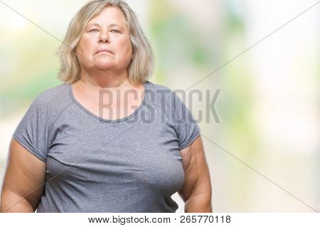 Senior plus size caucasian woman over isolated background with serious expression on face. Simple and natural looking at the camera.