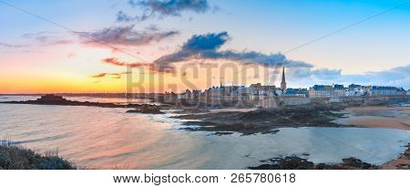 Panoramic view of walled city Saint-Malo with St Vincent Cathedral at sunrise at high tide. Saint-Maol is famous port city of Privateers is known as city corsaire, Brittany, France poster