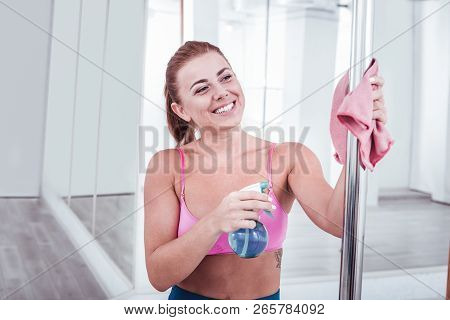 Beaming Pole Dancer Feeling Excited Before Starting Training Cleaning Pole