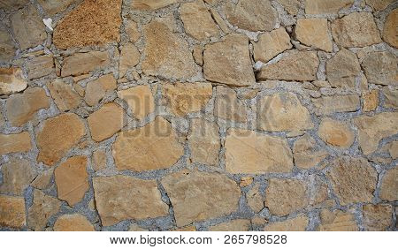 Texture Background Old Stone Wall. Wall Texture Of Ancient Old Brick Stone. Outdoor Exterior Castle