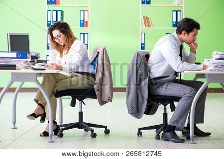 Two colleagues working in the office
