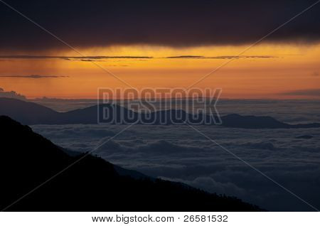 Cloudscape Over Mountains At Sunrise Sunset