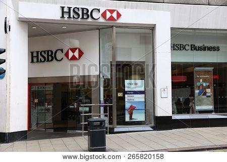 Leeds, Uk - July 12, 2016: People Walk By Hsbc Bank In Leeds, Uk. Hsbc Is One Of Largest Bank Groups