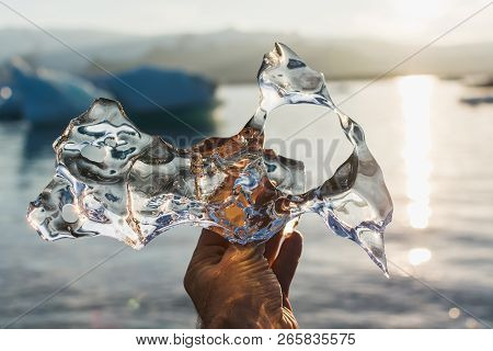 Transparent Piece Of Ice Melting In A Hand In Jokulsarlon Lagoon, Iceland