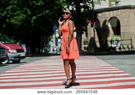 Stylish African American Woman Walking On Crosswalk Or Pedestrian Crossing And Speaking On Mobile Ph