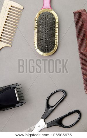 Some barber's accessories over gray background