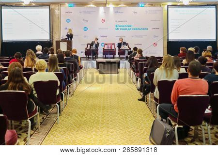 MOSCOW - JAN 20, 2018: People in auditorium and speaker at Conference Epilepsy, from gene to scalpel in InterContinental Moscow - Tverskaya hotel