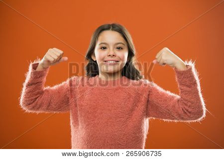 Child Cute Girl Show Biceps Gesture Of Power And Strength. Feel So Powerful. Girls Rules Concept. Up