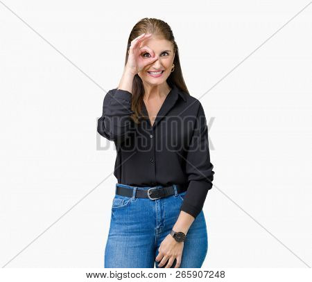 Beautiful middle age mature business woman over isolated background doing ok gesture with hand smiling, eye looking through fingers with happy face.
